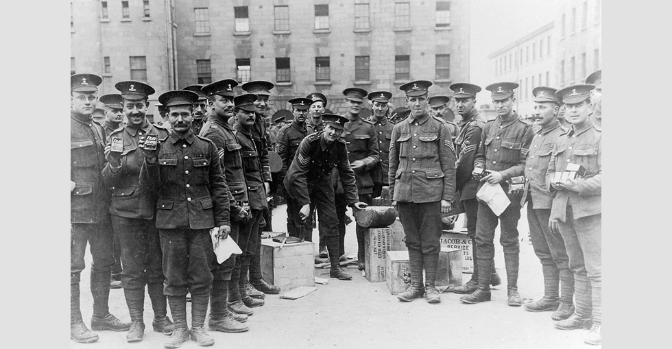 A group of soldiers stand with their food supply for the journey to Basingstoke.