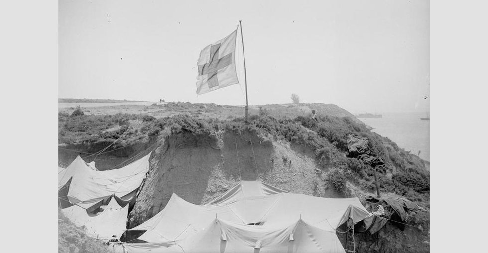 An advanced dressing station in the shelter of a rocky cliff at Gurkha Bluff 'Y' Ravine manned by 42nd Division