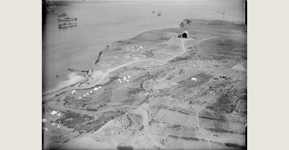 Aerial view of a location in the Dardanelles, showing camps and warships in the harbour, 29 March 1915