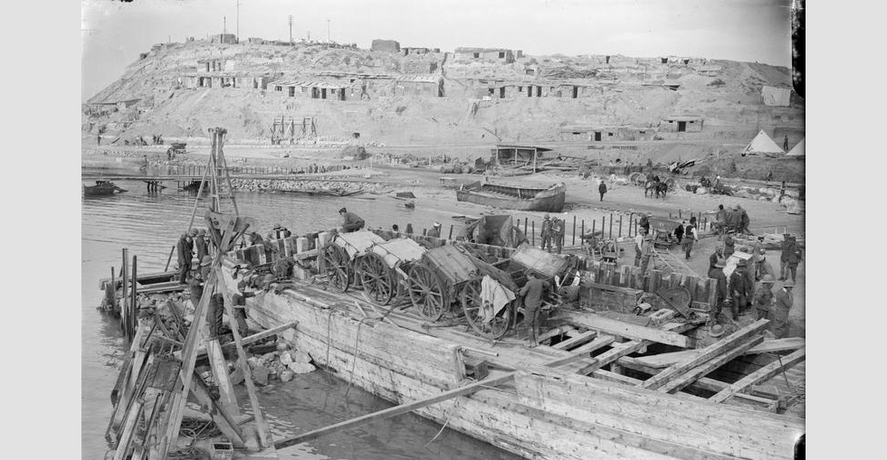 Artillery limbers being off-loaded at W Beach, Cape Helles.