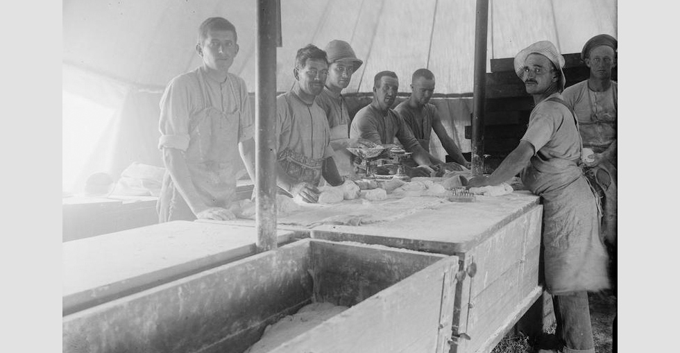 Bread making in tents on 'Bakery Beach'. The first issue of bread was made on 21 May 1915.