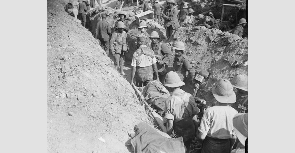 Congestion in a communication trench, with walking wounded and stretcher cases going down.