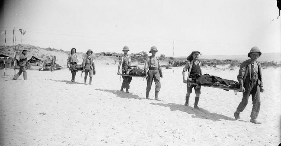 Carrying the wounded on stretchers from hospital to the jetty for transshipment to the Hospital Ship.