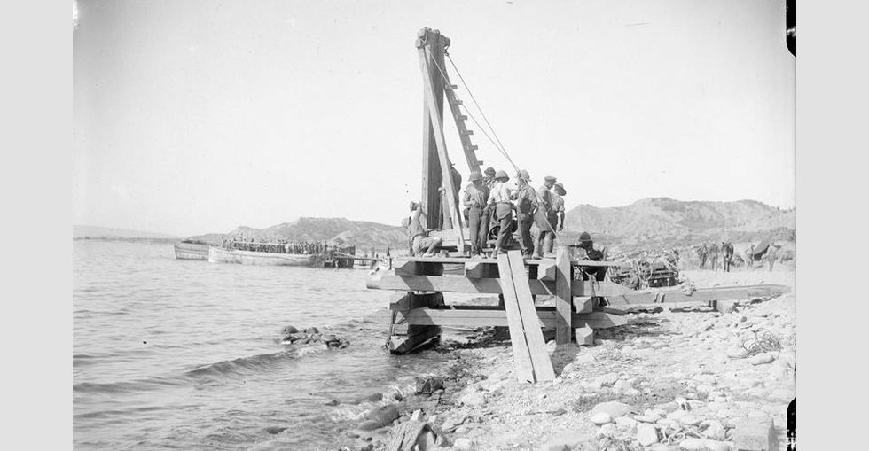British soldiers using a pile driver for the construction of a pier and jetty.