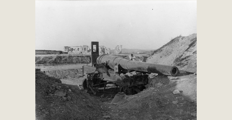 A scene after the naval bombardment of the Dardanelles ports, prior to the Gallipoli landings. The 9.4 inch coastal defence gun on Fort I (Cape Helles) having been dismounted by a direct hit.