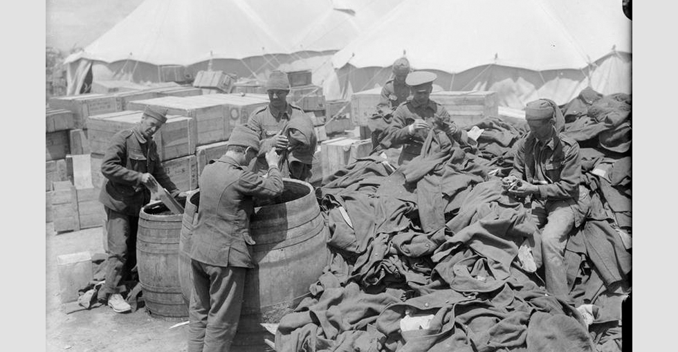Men of the Army Ordnance Corps disinfecting clothing in improvised disinfectors, known as Serbian barrels.