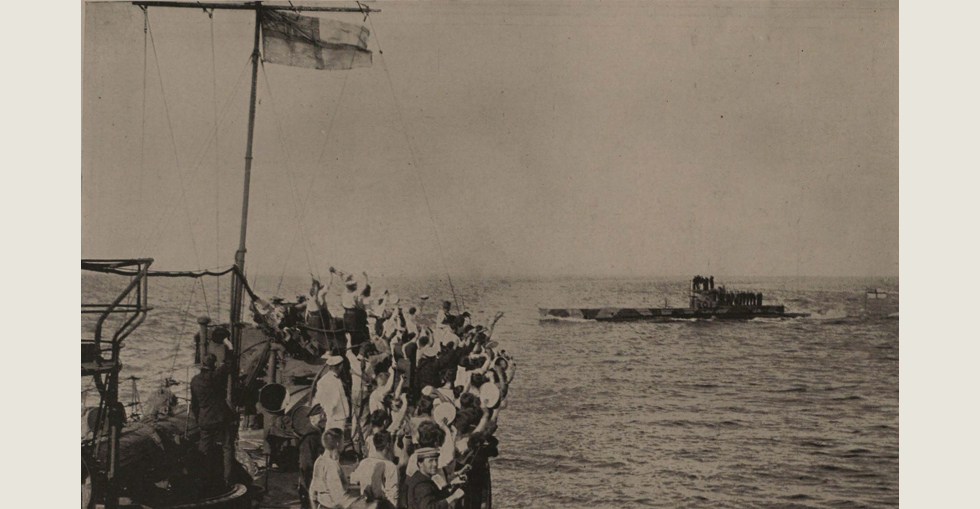 The crew of the HMS Grampus cheering the British submarine E-II which torpedoed a Turkish transport in Constantinople Harbour in May 1915