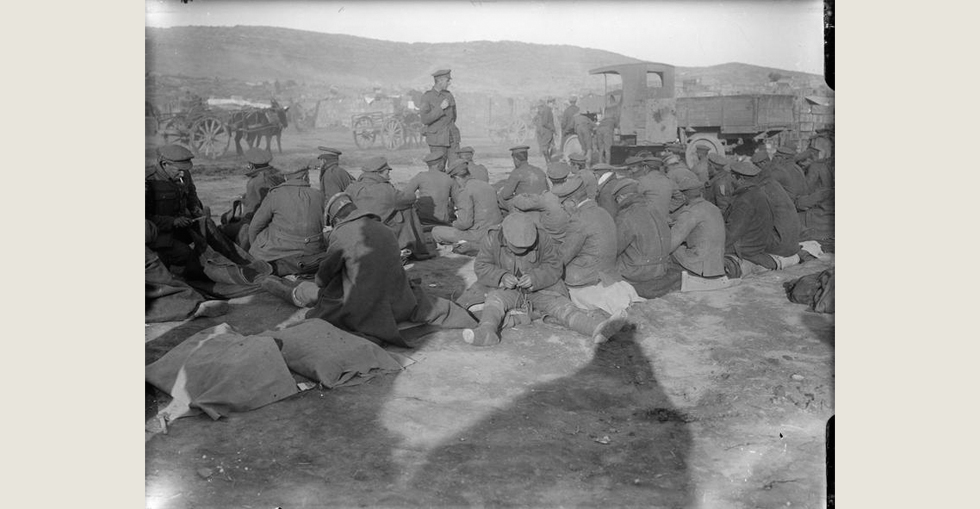 Frost-bitten British soldiers at Suvla Bay waiting to be evacuated by lorry during severe weather, November 1915.