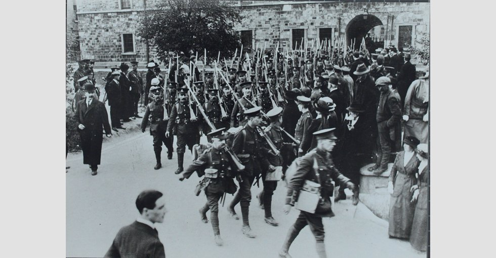 Crowds gathered to watch the men depart through the main gate at the Royal Barracks