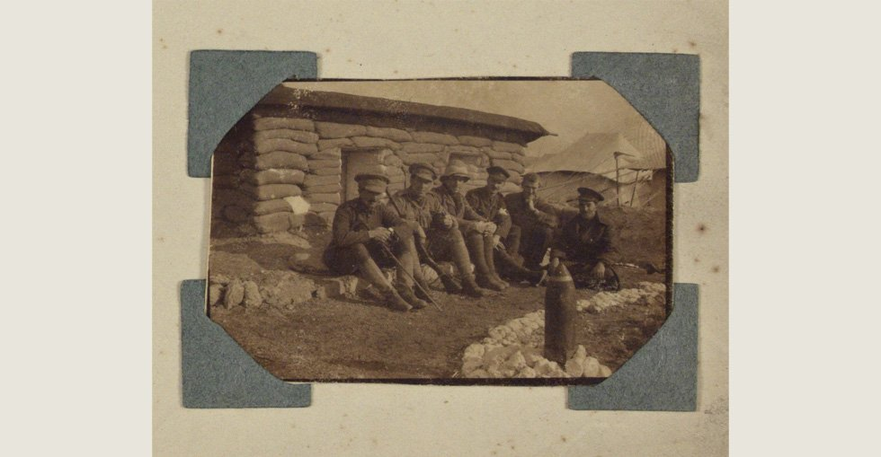 Group of soldiers outside a dugout