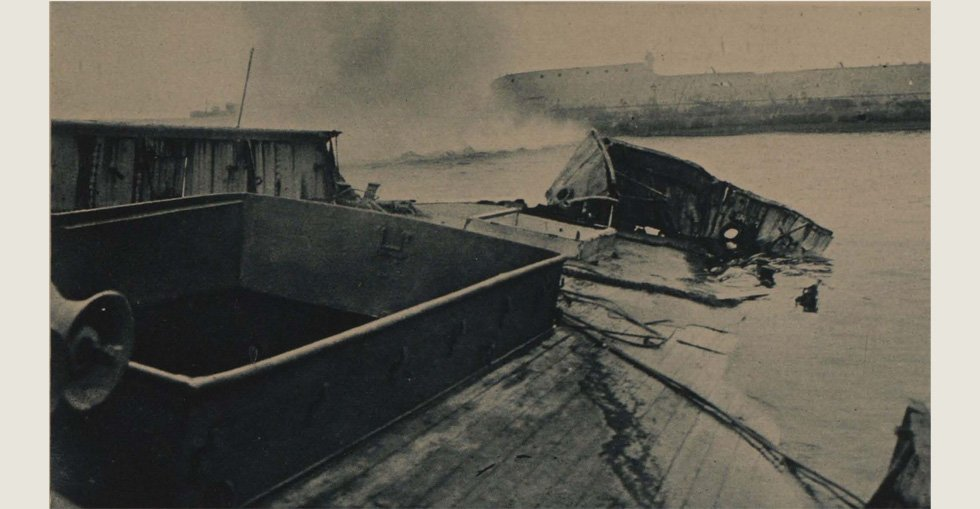 A snapshot on the day of the final evacuation - a Turkish shell drops near the pier at Lancashire Landing, Cape Helles