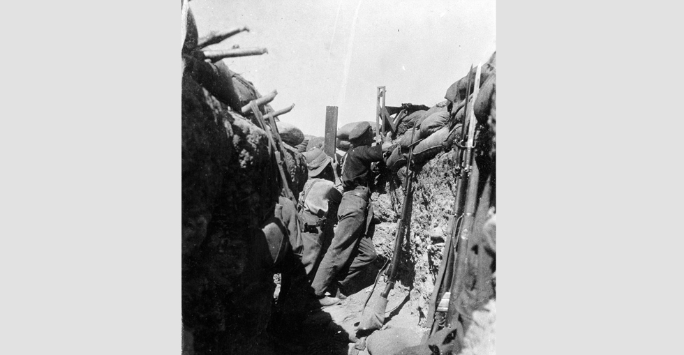 Soldiers in a trench using a periscope rifle