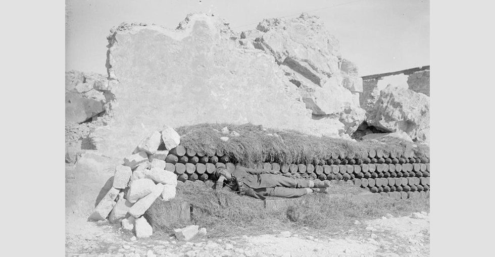 A shell dump in the ruins of the old fort at Sedd-el Bahr, Cape Helles, screened from aerial observation by cut grass.