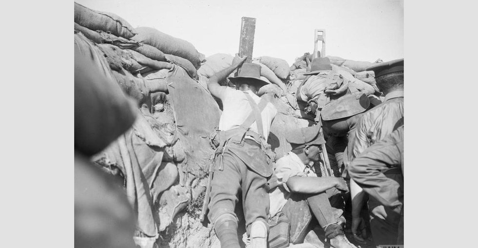 Men of the Royal Naval Division and Australians in the same trench. One is using a 'sniperscope' and another a periscope.