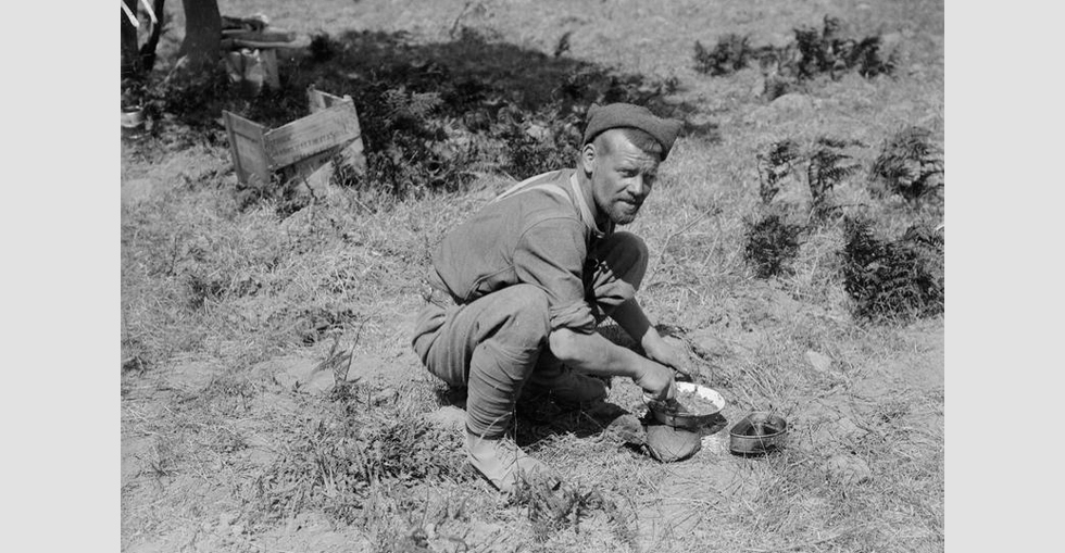 A soldier preparing a meal in a rest camp, possibly at Cape Helles.