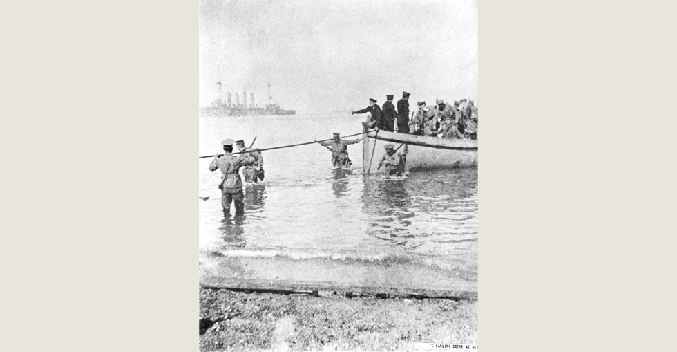 Troops disembark on the beach, 25 April 1915. Directed by sailors from a destroyer, a tie line is secured so troops can disembark on the beach.