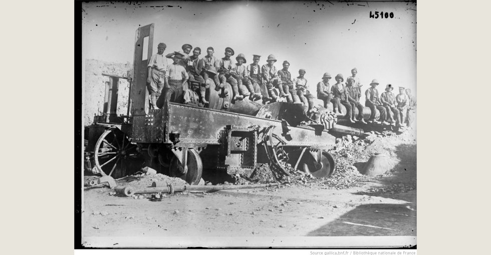 Turkish cannon at Cape Helles, large-caliber gun with British soldiers posing sitting above