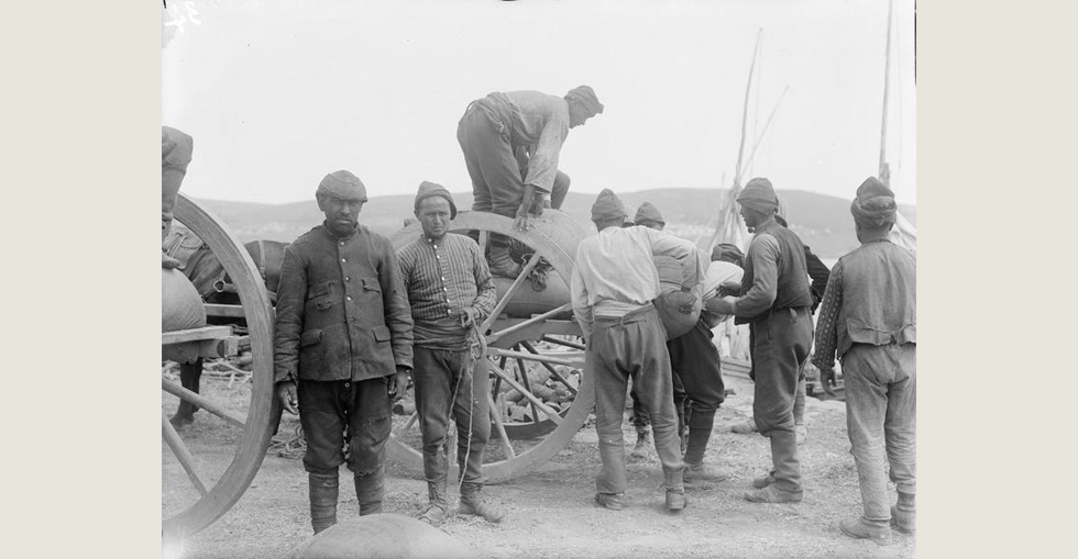 Turkish prisoners, captured during the Gallipoli campaign, loading a cart in the French Sector of V Beach at Sedd el Bahr, Cape Helles.