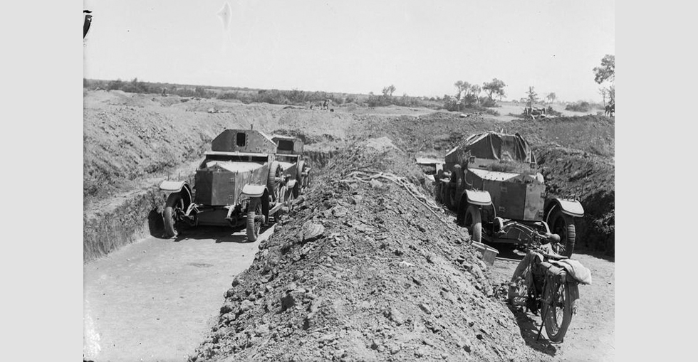 Two Rolls-Royce cars of the Armoured Car Section of the Royal Naval Division, under Lieutenant Commander Josiah Wedgwood, in the shelters dug to minimise the risks from shell fire.