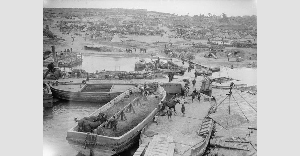 A view of 'V' Beach, Cape Helles, taken from transport ship River Clyde. Horses are disembarked from the nearest lighter.
