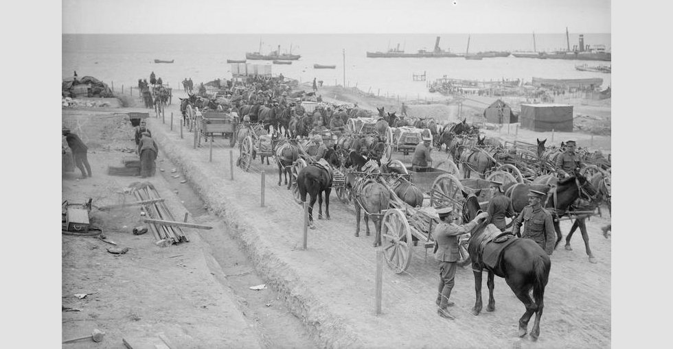 Water carts and other vehicles waiting for their turn to draw the water ration from the tanks on the coast