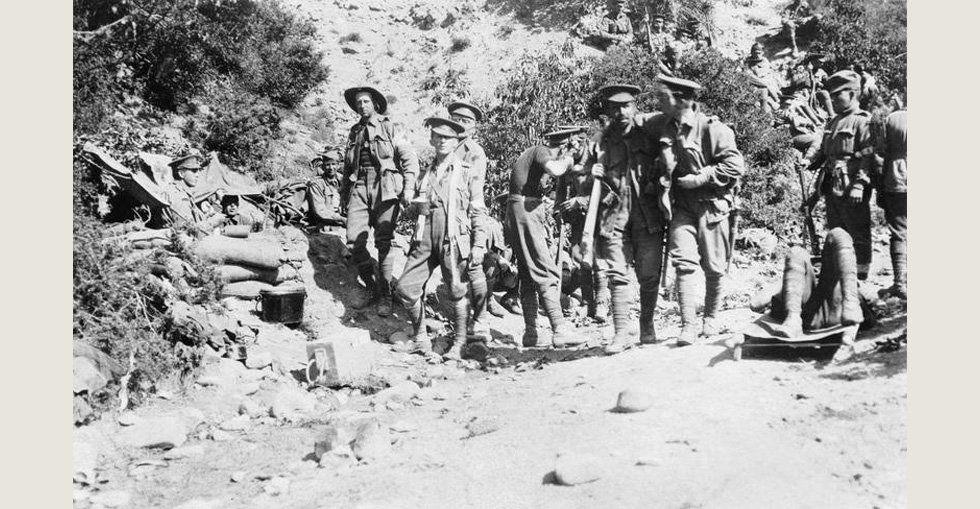 Wounded soldiers head for the Australian 3rd Battalion dressing station in Shrapnel Gully, Gallipoli, on 26 April 1915.