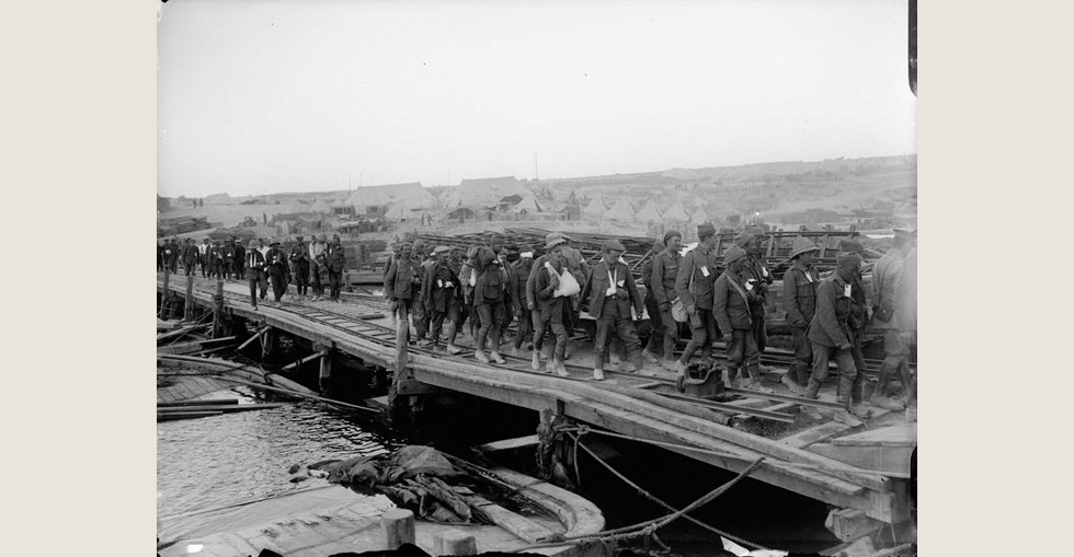 Wounded soldiers about to embark on a Hospital Ship